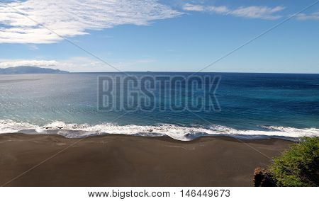 Fonti di Billa with its constant fierce waves and sand dunes is a scenic long stretch of black sand beach off the capital city of Sao Filipe Fogo Cabo Verde stock photo