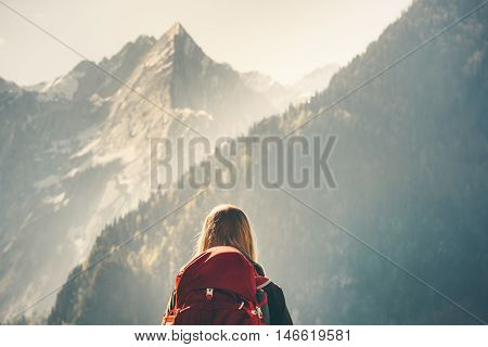 Woman backpacker enjoying rocky mountains view hiking Travel Lifestyle concept adventure vacations outdoor