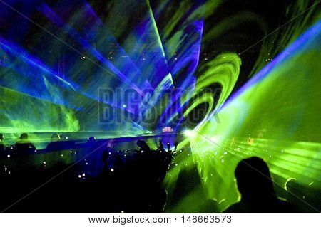 Crowd of people and laser show at rave party stock photo