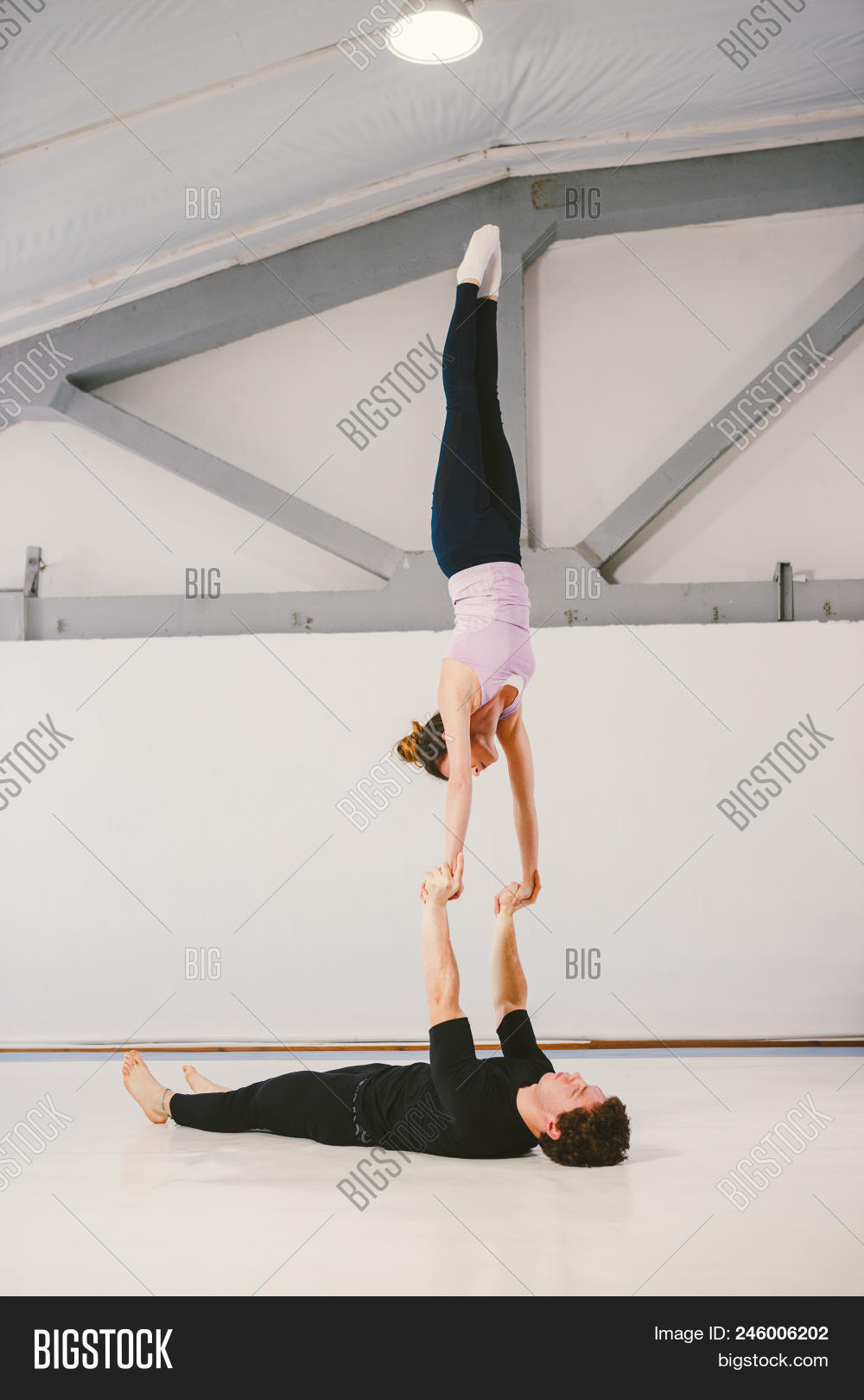 Young Caucasian Male And Female Couple Practicing Acrobatic Yoga In A White Gym On Mats Loy Hand To 246006202 Image Stock Photo