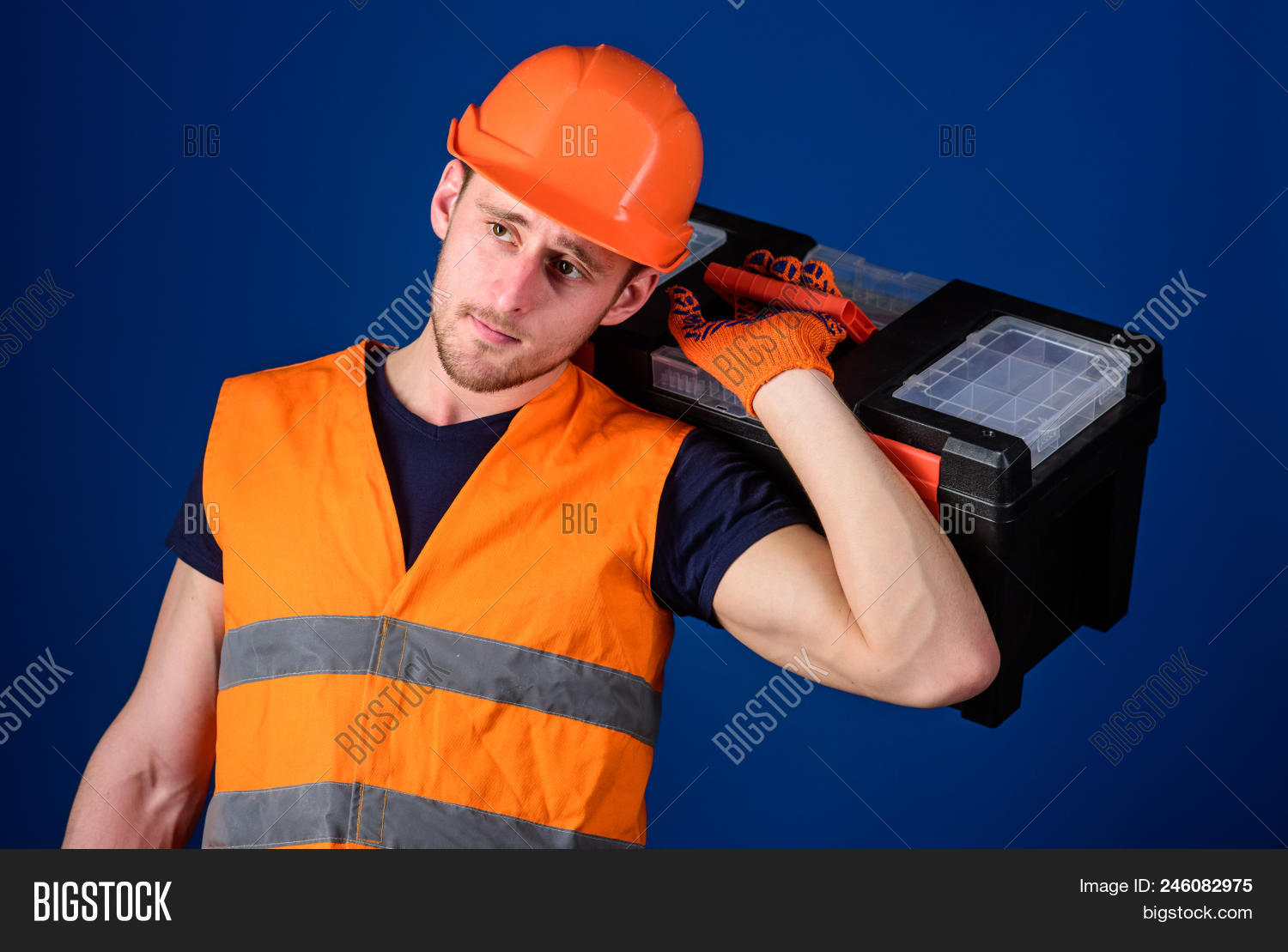 background,beard,bearded,blue,build,builder,carry,case,caucasian,concept,construction,constructor,contractor,developer,engineering,equipment,face,guy,handsome,hard,hat,helmet,helpful,hold,laborer,man,mechanic,problem,professional,ready,renovation,repair,repairer,repairman,service,shoulder,solve,strong,technician,thoughtful,tool,toolbox,uniform,unshaven,work,worker