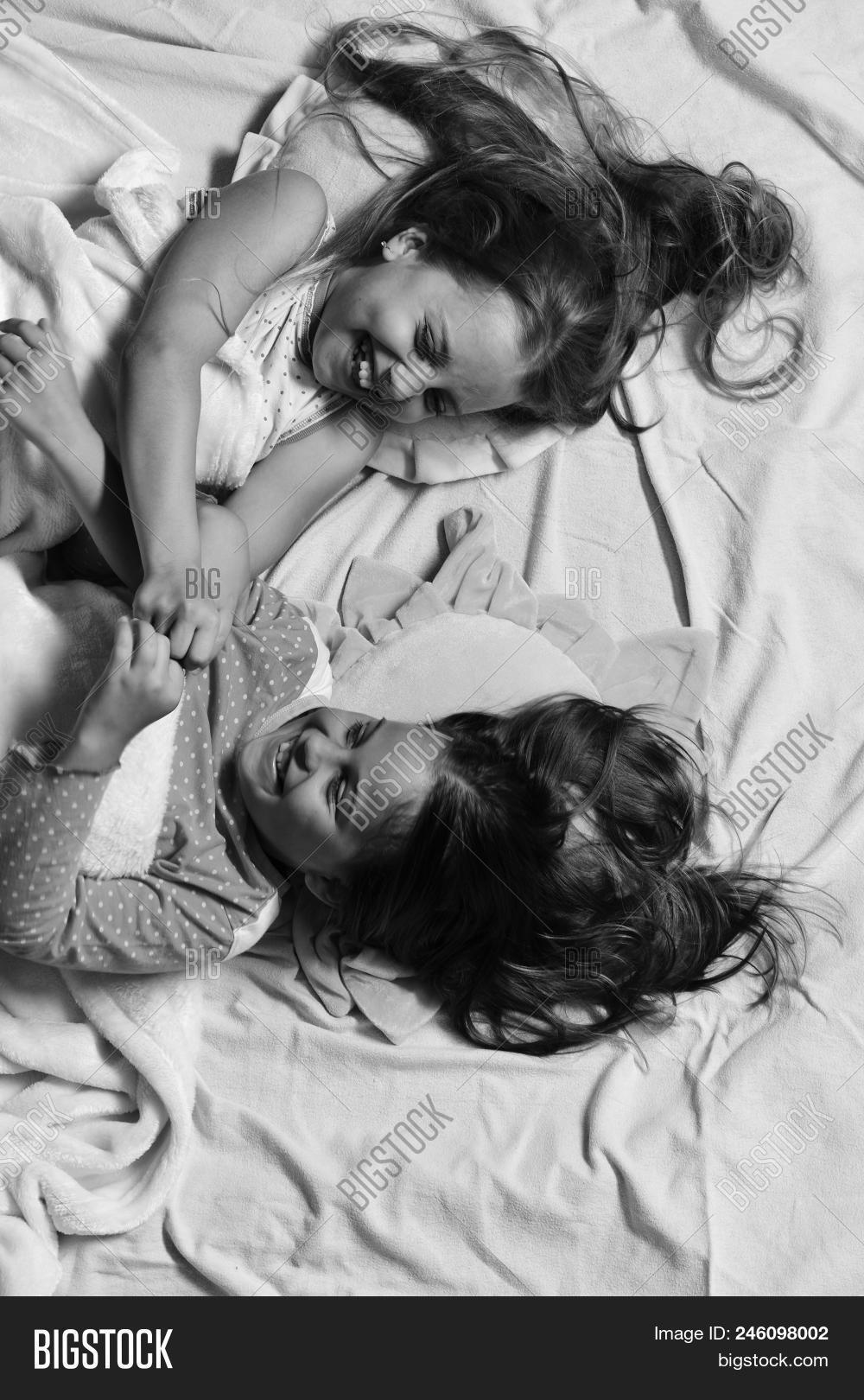 adorable,beautiful,bed,bedroom,blanket,caucasian,child,childhood,children,colorful,concept,face,fight,fighting,friendship,fun,girl,hair,hairdo,hairdresser,happiness,happy,have,kid,lie,long,lying,morning,night,pajama,party,pillow,pink,pretty,schoolgirl,schoolkid,sheet,top,topview,view,wallow,white
