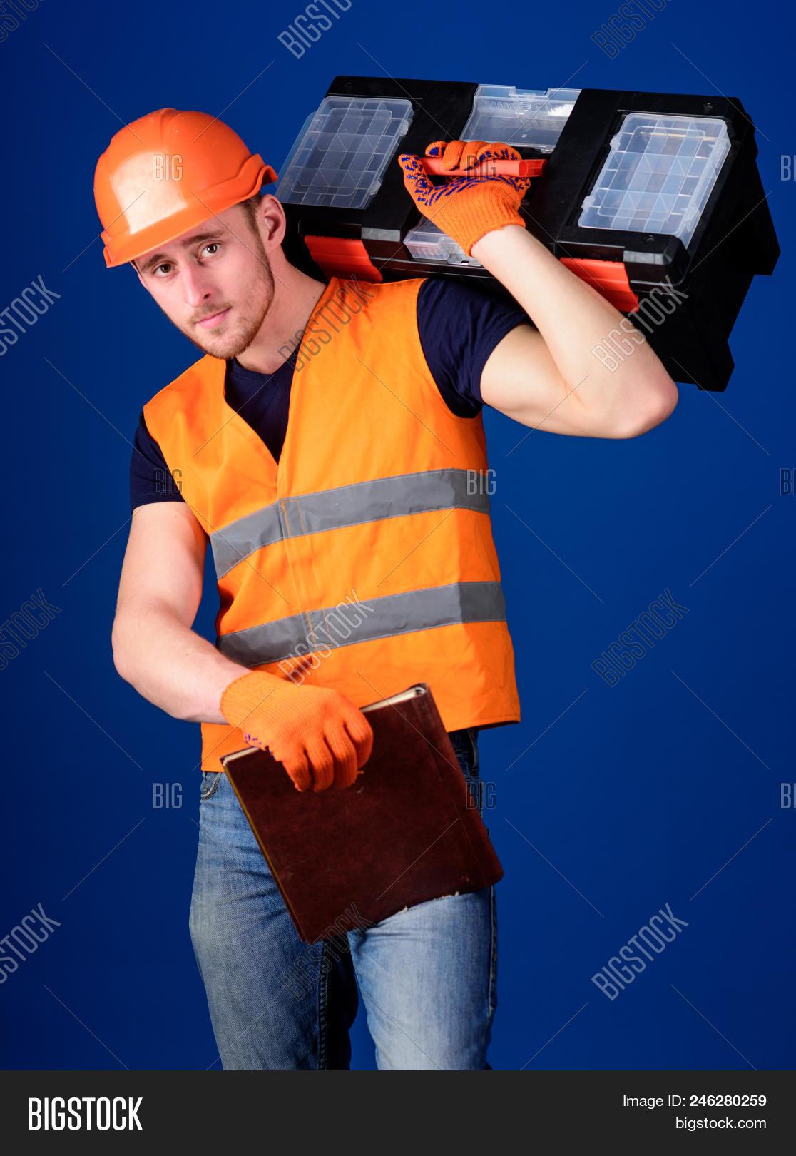 background,beard,bearded,blue,build,builder,calm,carry,case,caucasian,concept,construction,constructor,contractor,developer,document,engineering,equipment,face,fix,folder,guy,handsome,hard,hat,helmet,helpful,hold,laborer,man,mechanic,problem,professional,ready,repair,repairer,repairman,service,shoulder,solve,strong,technician,tool,toolbox,uniform,unshaven,work,worker