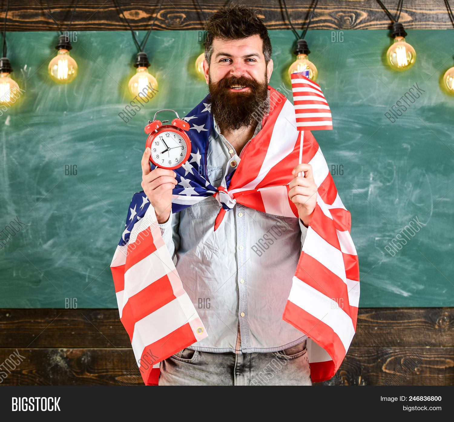 4th,adult,alarm,american,back,background,beard,bearded,casual,caucasian,celebrate,chalkboard,classroom,clock,college,concept,education,educational,face,flag,guy,hand,happy,hipster,hold,holiday,independence,july,knowledge,lecturer,man,mustache,national,patriot,patriotic,person,schedule,school,smile,stand,student,study,system,teach,teacher,time,to,university,unshaven,usa