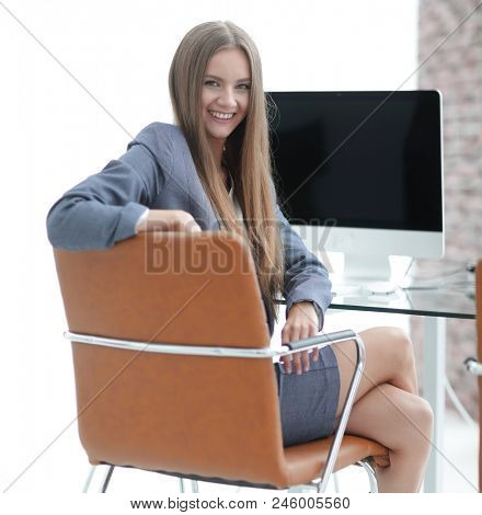 woman administrator sitting at the workplace stock photo