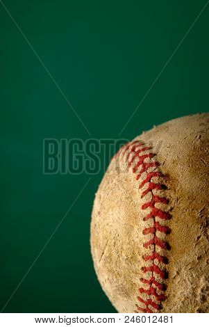 Old worn baseball with leather texture for sport and recreation stock photo