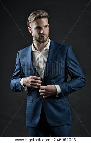 Stylish and successful. Most businesses explicit saying dress code professional attire no second guessing. Man well groomed formal suit dark background. Business dress code. Guy formal outfit. stock photo