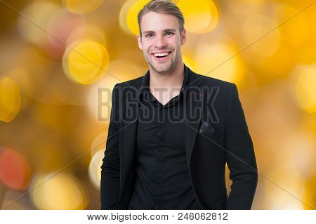 Corporate dress code. Man happy formal black suit festive blurred background. Business casual. Casual look made for professional environment and festive corporate events. Corporate culture. stock photo
