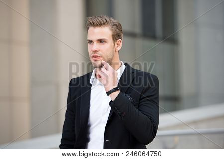 Man formal suit businessman well groomed urban background. Professional attire wear in professional environments. Uniform business environments decorum professionalism woven culture organization. stock photo