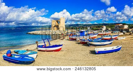 Traditional fishing village Briatico with colorful boats and old saracen tower . Calabria, Italy stock photo