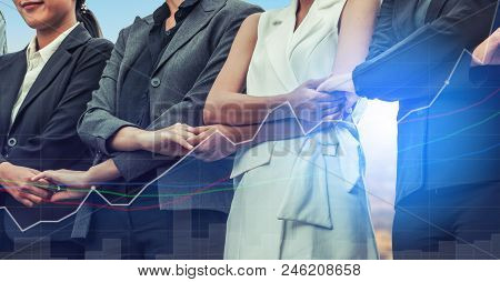Double exposure business people holding hands together showing workers relationship, unity and teamwork. Human resources and people recruitment concept. stock photo