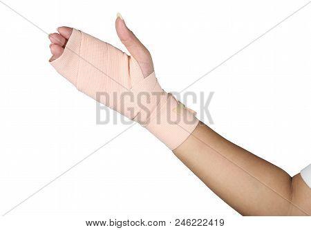 Arm splint, hand bandage, gauze bandage patient with Asian girl hand wrap injury isolated on white background. stock photo