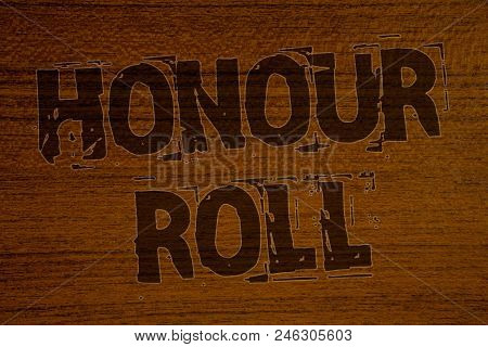 Conceptual hand writing showing Honour Roll. Business photo showcasing List of students who have earned grades above a specific averageBold brown letters words ideas on wooden background stock photo