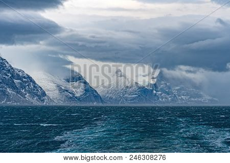 Storm Clouds above an Ocean Fjord in the Sam Ford Fjord in Baffin Island in Nunavut, Canada stock photo