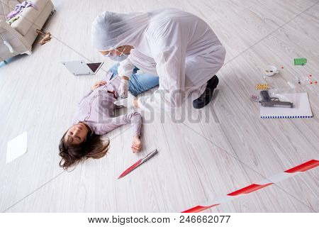 Forensic investigator at the crime scene investigating woman mur stock photo