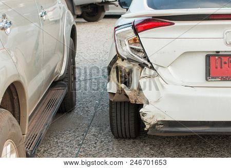 Vehicle shows damage at the rear end of the white car.Distracted driver rear ended vehicle at stop sign,texting well driving stock photo