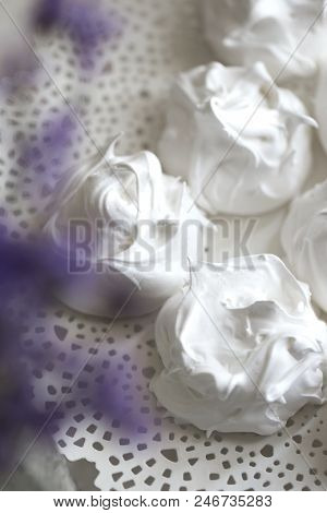 meringue decorated with lavender. French  meringue cookies, macro shot. stock photo