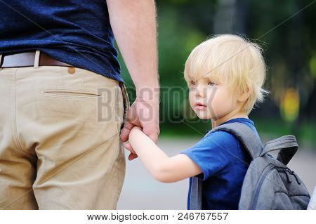 Back to school concept. Little pupil with his father. First day of primary school. Education for small kids. stock photo