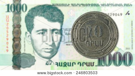 10 armenian dram coin against 1000 armenian dram bank note obverse stock photo