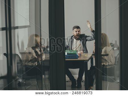 Director shout at secretary in office. Director and business woman discuss company budget, savings and handout concept. stock photo