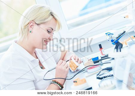 dental technician or prosthesis worker. prosthetic dentistry process stock photo