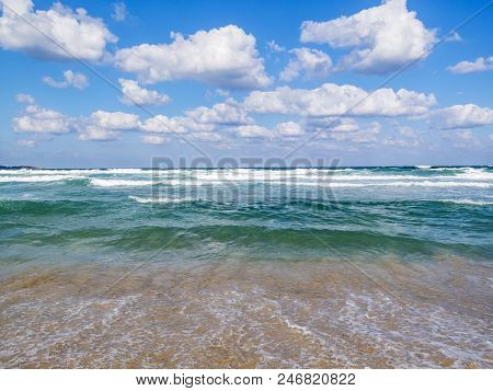 Bulgarian Black Sea coastline water expanse view with fluffy white cumulus clouds in the sky stock photo