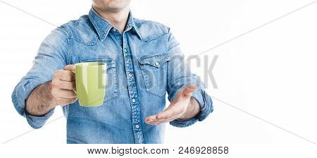 A man in casual style wear suggesting cup of coffee. Invite customer to taste. No face, closeup banner on white background, copy space. stock photo
