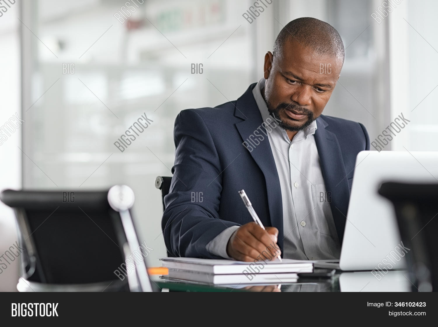 african,african business man,agency,american,black,black entrepreneur,book,business,business documents,business man,businessman,busy,commitment,computer,concentrated,concentration,consultant,copy space,corporate,desk,document,employee,entrepreneur,executive,focused man,laptop,manager,mature,modern,modern office,note,occupation,office,one,pen,professional,project,real people,research,result,serious,serious man,sitting,sitting at desk,strategy,taking,work,working on computer,writing,writing notes