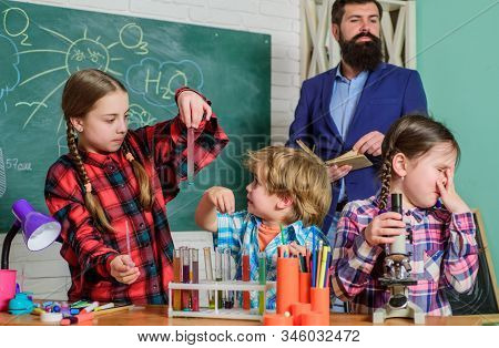 Experience become knowledge. Group interaction communication. Science club is successful approach to STEM education. Practical knowledge. Elementary basic knowledge. Study with friends is fun stock photo