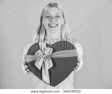 Female hands hold gift box. Prepared something special for him. She romantic person. Valentines gift for boyfriend. Find special gift for boyfriend fiance or husband. Romantic surprise gift for him stock photo