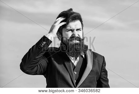 Bearded man. Mature hipster with beard. Businessman against the sky. Future success. Male formal fashion. brutal caucasian hipster with moustache. Bearded man touch beard. Man with beard outdoor stock photo
