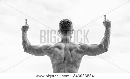 Great shape. Achieve success. Successful athlete. Victory and success. Champion and winner concept. Man celebrating success. Bodybuilder strong muscular body feeling powerful and superior rear view stock photo