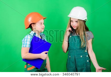 Renovation plan. Home improvement activities. Builder engineer architect. Future profession. Kids girls planning renovation. Initiative children girls provide renovation their room green background stock photo