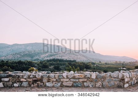 Architecture and nature of Turkey.Ruins of old city.Archaeological excavations.Old red brick arch.Ruins on background of mountains. City view.Background for travel.Trees and mountains.Selcuk,Turkey. stock photo