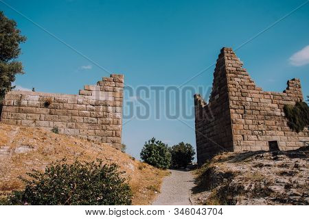 Minos Gate in Bodrum,Turkey.Museum in the open.Architecture of ancient Greece. Destroyed structure.Traveling in hot countries. Leisure.Old stone building.Aesthetic photography.Myths about the gods. stock photo