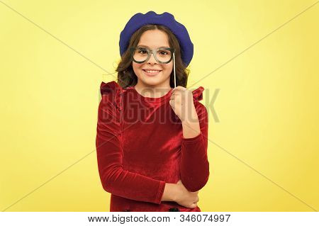 Accessory for celebration. Happy little child glasses props. Funny small girl holding glasses photo booth props on stick. Cute kid with fancy party props. Party decorations supplier. Party shop. stock photo
