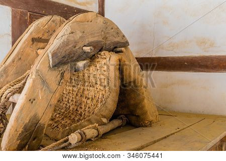 Antique wooden farm animal yoke with wicker mat on top of wooden cabinet. stock photo