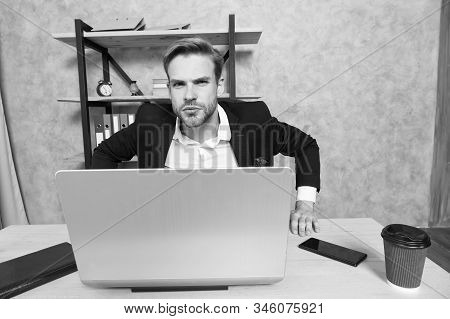 Man strict bearded boss top manager in office. Ceo concept. Leave office right now. Failed job interview. Firing employees. Serious boss picky looking at camera. Boss with laptop in bad mood. stock photo