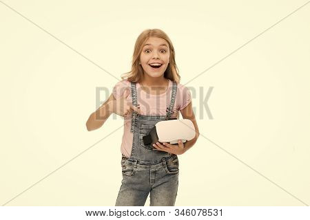 Cool. Cyber gaming. future technology. Virtual reality is exciting. Girl little kid wear vr glasses isolated on white background. Virtual education concept. Modern life. Interaction in virtual space. stock photo