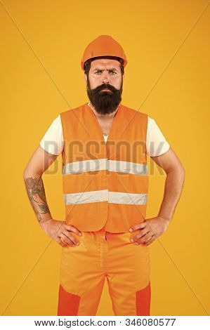 Safety apparel for construction industry. Bearded brutal hipster safety engineer. Man engineer protective uniform orange background. Engineering career concept. Architect builder engineer. Labor day. stock photo