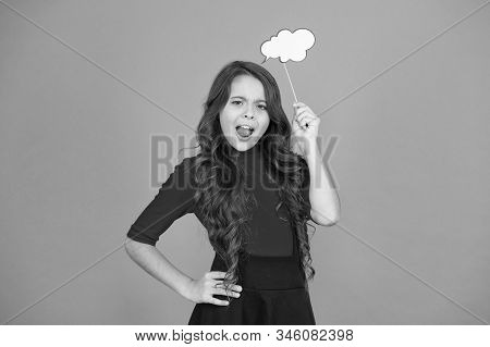 think positive. her thoughts. never know what she is thinking about. smart child with party cloud. pretty thoughtful kid long curly hair. have your opinion. whats on your mind. think of fashion. stock photo