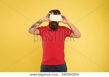 Creating reality. Man play game in VR glasses. Hipster with virtual reality headset. Explore cyberspace. Virtual communication. Virtual simulation. Digital technology. Building your visions. stock photo