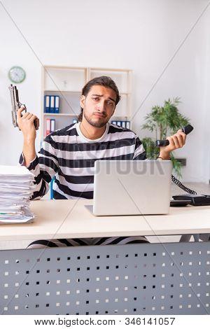 Young employee feeling like prisoner at work stock photo