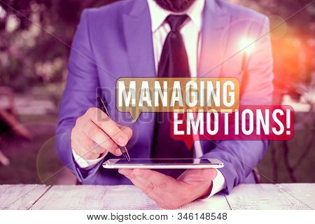 Text sign showing Managing Emotions. Conceptual photo ability be open to feelings and modulate them in oneself Businessman pointing with pen in empty copy space. stock photo