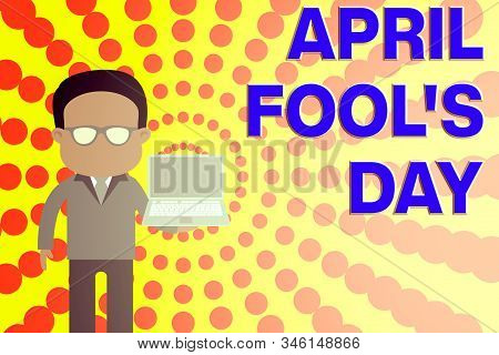 Conceptual hand writing showing April Fool S Day. Business photo showcasing Practical jokes humor pranks Celebration funny foolish Man in suit wearing eyeglasses holding open laptop photo Art. stock photo