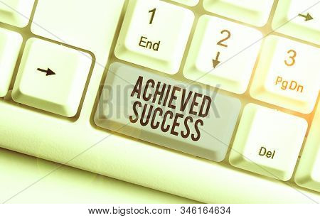 Writing note showing Achieved Success. Business photo showcasing the achievement of desired visions and planned goals. stock photo
