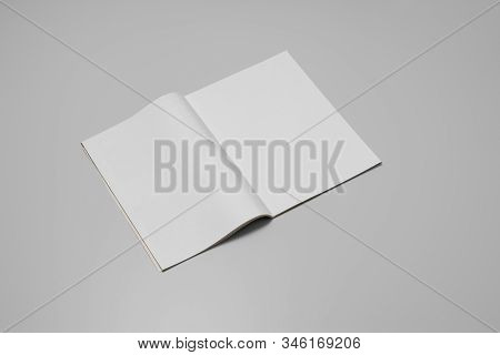 Mock-up magazine, newspaper or catalog on gray background. Blank page or notepad on paper backdrop. Blank page for mockups or simulations. stock photo