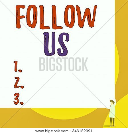 Conceptual hand writing showing Follow Us. Business photo showcasing To invite a demonstrating or group to join his company and take rules Young woman holding two hands right corner big rectangle. stock photo