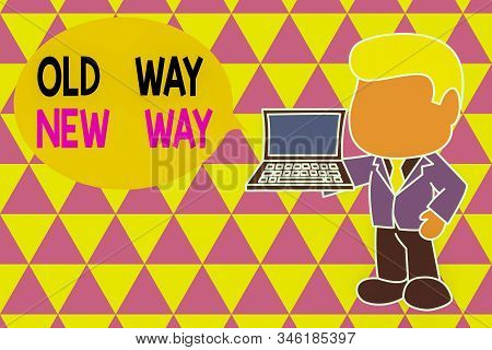 Word writing text Old Way New Way. Business concept for The different way to fulfill the desired purposes Standing professional businessman holding open laptop right hand side. stock photo