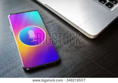 Virtual Voice Assistant and personal sound recognition application with deep learning AI siri on smartphone screen. Close-up mobile phone with microphone icon and waves sound icon. stock photo